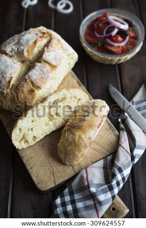 No knead homemade bread on dark wood table - stock photo