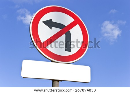 No left turn traffic sign over blue sky - stock photo