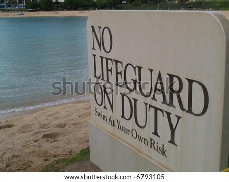 no lifeguard on duty - stock photo