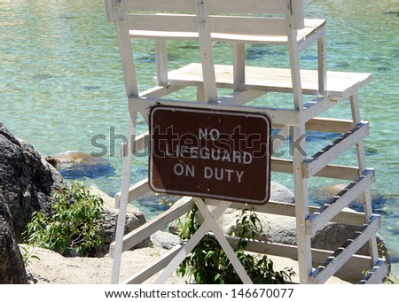 No lifeguard on duty chair on the shore of Lake Tahoe - stock photo
