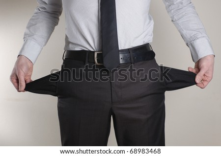 No Money. A broke businessman turns out his empty pockets. - stock photo