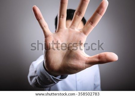 No More Concept,Stop Gesture. Man with raised opening hand making No more gesture. No more Unhealthy food, No more smoking,Alcohol. - stock photo