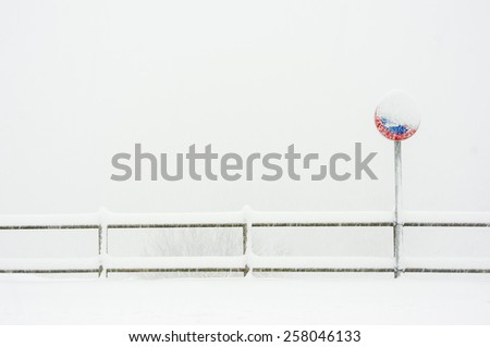 no parking sign in the snow - stock photo