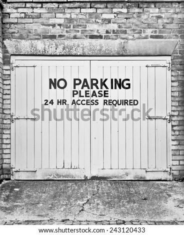 No parking sign on a garage door - stock photo