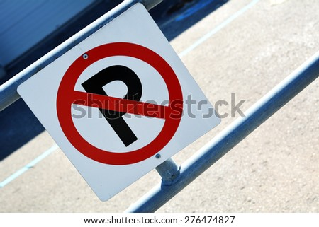 No Parking sign on fence  No parking sign white red and black no parking sign - stock photo
