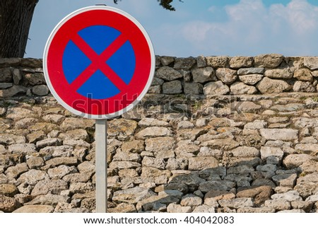no parking sign with grey sky - stock photo