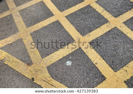 no parking yellow cross zone - stock photo