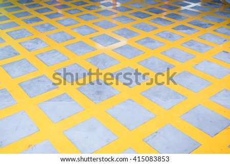 no parking yellow cross zone, criss-cross yellow lines painted on the road - stock photo