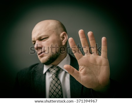 No photo! Man showing his hand as stop sign. - stock photo