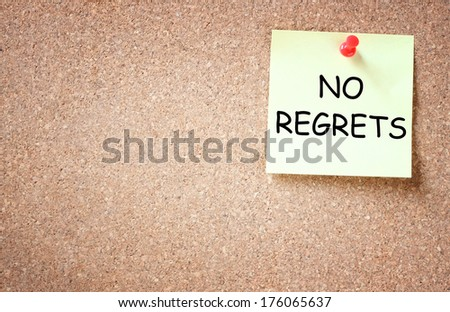 no regrets concept. sticky pinned to corck board with room for text - stock photo