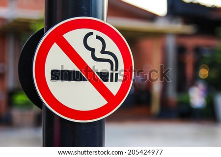 No smokin sign with a blurry background - stock photo