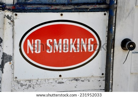 No smoking sign near the door - stock photo