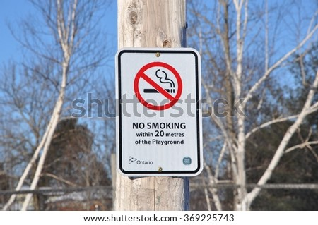 No smoking within 20 meters of the playground signage - stock photo