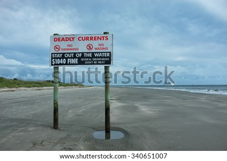 No swimming and no wading danger sign in Charleston on the shore. Several drowning - don't be next, 1040 fine. Deadly currents, stay out of the water. - stock photo