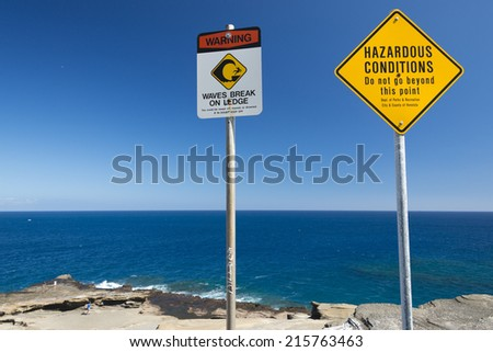 no swimming danger sign in hawaii on the shore - stock photo