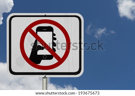 No Texting and Driving Sign, White Information sign with symbol of a hand and texting with blue sky background - stock photo