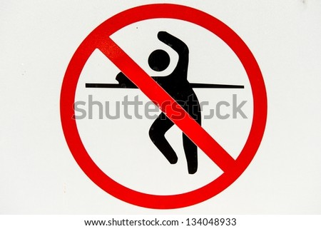 No trespassing and fence jumping danger sign, isolated - stock photo