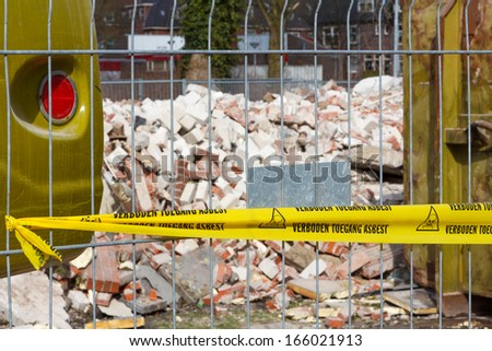 No Trespassing tape for asbestos in dutch at entrance of contaminated terrain - stock photo