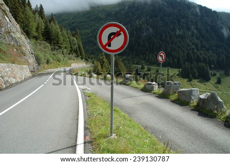 No turn signs on mountain road nearby Sustenpass in Alps in Switzerland - stock photo