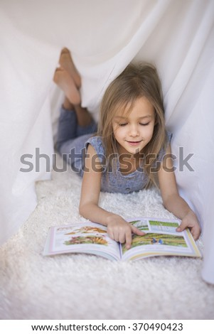Nobody disturbs her while reading - stock photo
