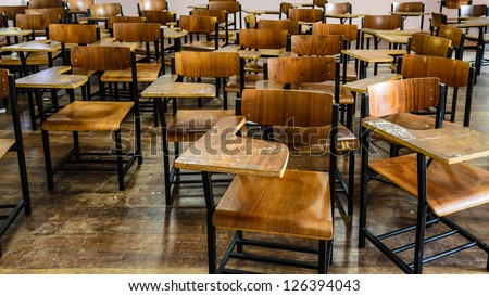 nobody, many wooden chairs in old schoolroom. - stock photo