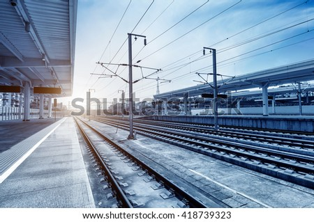 Nobody's railway station, blue tone image. - stock photo