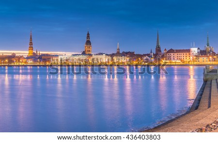 Nocturnal view on old city of Riga from embankment of the Daugava river. In 2014, Riga was the European capital of culture - stock photo