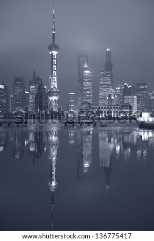 Nocturne view at Pudong with Oriental Pearl Tower, Financial and Jin Mao towers. B&W finition. - stock photo