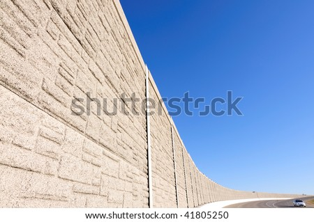 noise barrier fence on the highway - stock photo