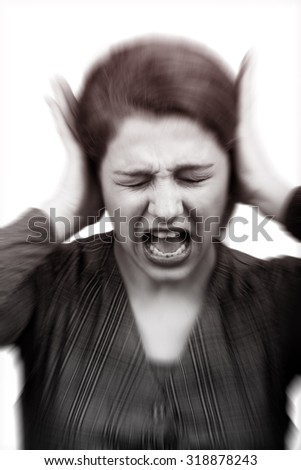 Noise stress concept - stressed woman covering ears - stock photo
