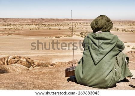 nomad man in the desert , zamur region , western sahara - stock photo