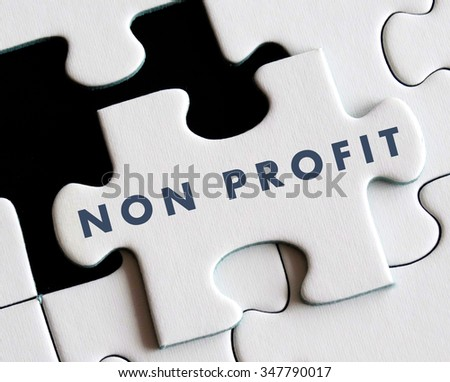 Non profit text on missing puzzle. - stock photo