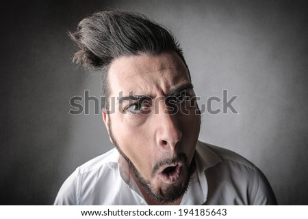 nonsense face - stock photo