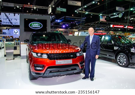 NONTHABURI - NOVEMBER 28:  Range Rover Sport with Unidentified business man on display at Thailand International Motor Expo 2014 on November 28, 2014 in Nonthaburi, Thailand. - stock photo