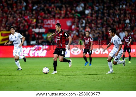 NONTHABURI THAI-FEB 21:Cleiton Silva#23 of Muangthong Utd.run with the ball during Thai Premier League between SCG Muangthong UTD. and Buriram UTD.at SCG Stadium on February 21,2015 in,Thailand - stock photo