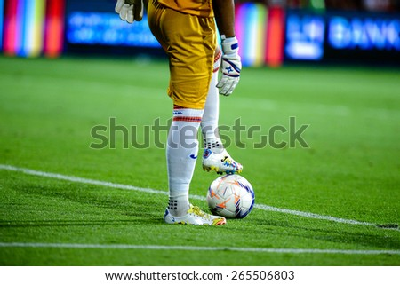 NONTHABURI THAI-Mar 07:shoe and football detail during the Thai Premier League 2015 between SCG Muangthong UTD. and Port F.C. at SCG Stadium on March 07,2015 in,Thailand - stock photo