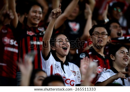 NONTHABURI THAI-Mar 07:Unidentified fan Muangthong utd. supporters during the Thai Premier League 2015 between SCG Muangthong UTD. and Port F.C. at SCG Stadium on March 07,2015 in,Thailand - stock photo