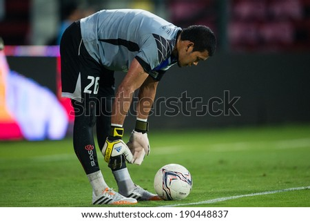 NONTHABURI THAILAND-APR19:Goalkeeper Kawin Thamsatchanan of Muangthong Utd.in action during Thai Premier League between Muangthong Utd.and Chiangrai Utd.at SCG Stadium on April 19,2014,Thailand - stock photo
