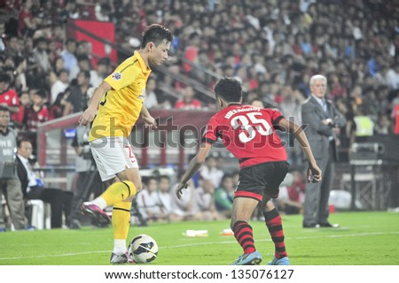 NONTHABURI, THAILAND- APRIL 9 : Gao Lin (L) in action during AFC Champions  League 2013 Between Muangthong Utd (R) VS Guangzhou Evergrande (Y) on April 9, 2013 at SCG Stadium, Bangkok,Thailand - stock photo