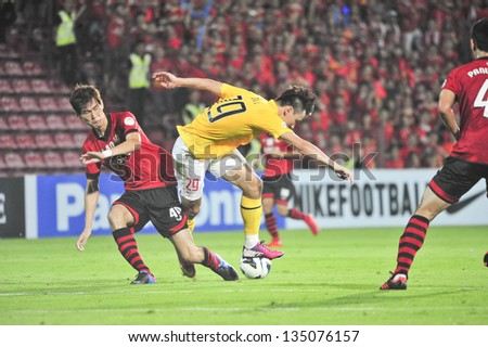 NONTHABURI, THAILAND- APRIL 9 : Gao Lin (Y) in action during AFC Champions  League 2013 Between Muangthong Utd (R) VS Guangzhou Evergrande (Y) on April 9, 2013 at SCG Stadium, Bangkok,Thailand - stock photo