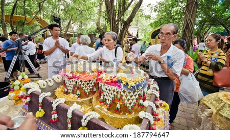 NONTHABURI THAILAND-APRIL 13: people showering Buddhist relics in Songkran festival in temple on April 13, 2014 in Nonthaburi,Thailand . - stock photo