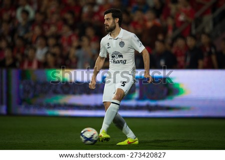NONTHABURI THAILAND-FEBRUARY 21:	Andres Tunez of Buriram United  for the ball during Thai Premier League between Muangthong Utd.and Buriram United at SCG Stadium on Feb 21, 2015,Thailand - stock photo