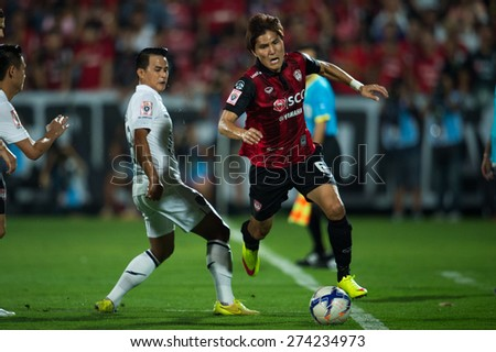 NONTHABURI THAILAND-FEBRUARY 21:	Kim Dong-Jin (RED) of  Muangthong Utd. in action during Thai Premier League between Muangthong Utd.and Buriram United at SCG Stadium on Feb 21, 2015,Thailand - stock photo