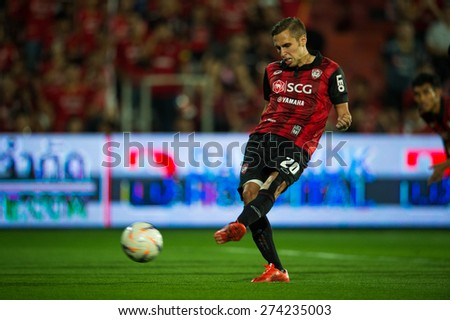 NONTHABURI THAILAND-FEBRUARY 21:	Mario Gjurovski of  Muangthong Utd. in action during Thai Premier League between Muangthong Utd.and Buriram United at SCG Stadium on Feb 21, 2015,Thailand - stock photo