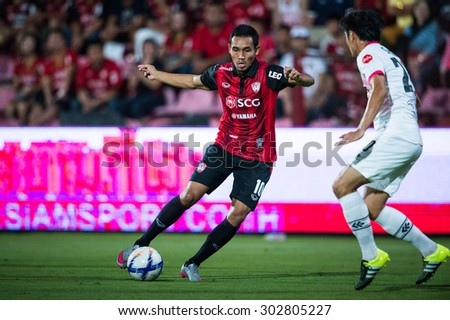 NONTHABURI THAILAND-JULY 25 :Teerasil Dangda (L) of Muangthong Utd. in action during Thai Premier League between Muangthong Utd.and Saraburi FC at SCG Stadium on July 25, 2015,Thailand - stock photo