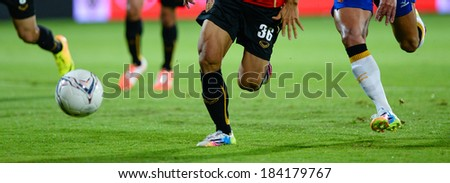 NONTHABURI THAILAND-MARCH 26:Detail of a player boots during  the Thai Premier League (TPL) between SCG MTUTD Utd vs ratchaburi fc on March 26,2014 at SCG Stadium in Nonthaburi Thailand  - stock photo