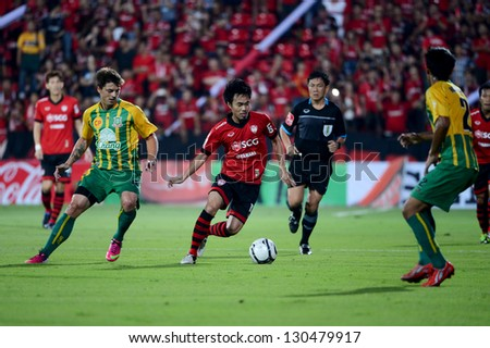 NONTHABURI THAILAND-MARCH 3:Phichitphong Choeichiu (Red)of SCGMuangthong Utd. in action during Thai Premier League between SCGMuangthong Utd.and  Army United F.C. on March3,2013 in Nonthaburi,Thailand - stock photo