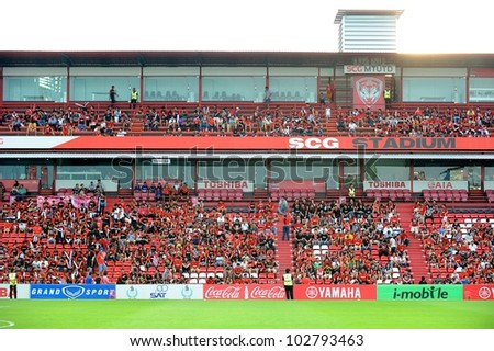 NONTHABURI THAILAND-MAY 17:Unidentified SCG MuangThong utd. supporters during Thai Premier League between SCG Muangthong Utd.and Army United FC.on May17,2012 in Nonthaburi,Thailand - stock photo