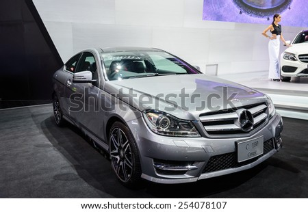 NONTHABURI, THAILAND - NOVEMBER 28: The Mercedes Benz C180 Coupe is on display at the 31st Thailand International Motor Expo 2014 on November 28, 2014 in Nonthaburi, Thailand. - stock photo