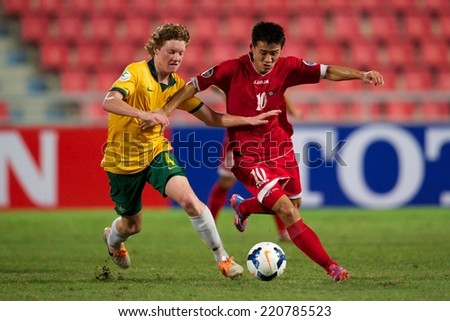 NONTHABURI THAILAND-SEPTEMBER 17:Choe Song Hyok no.10 (L) of DPR Korea in action during the AFC U-16 Championship between Australia and DPR Korea at Rajamangala Stadium on Sep17,2014,Thailand - stock photo